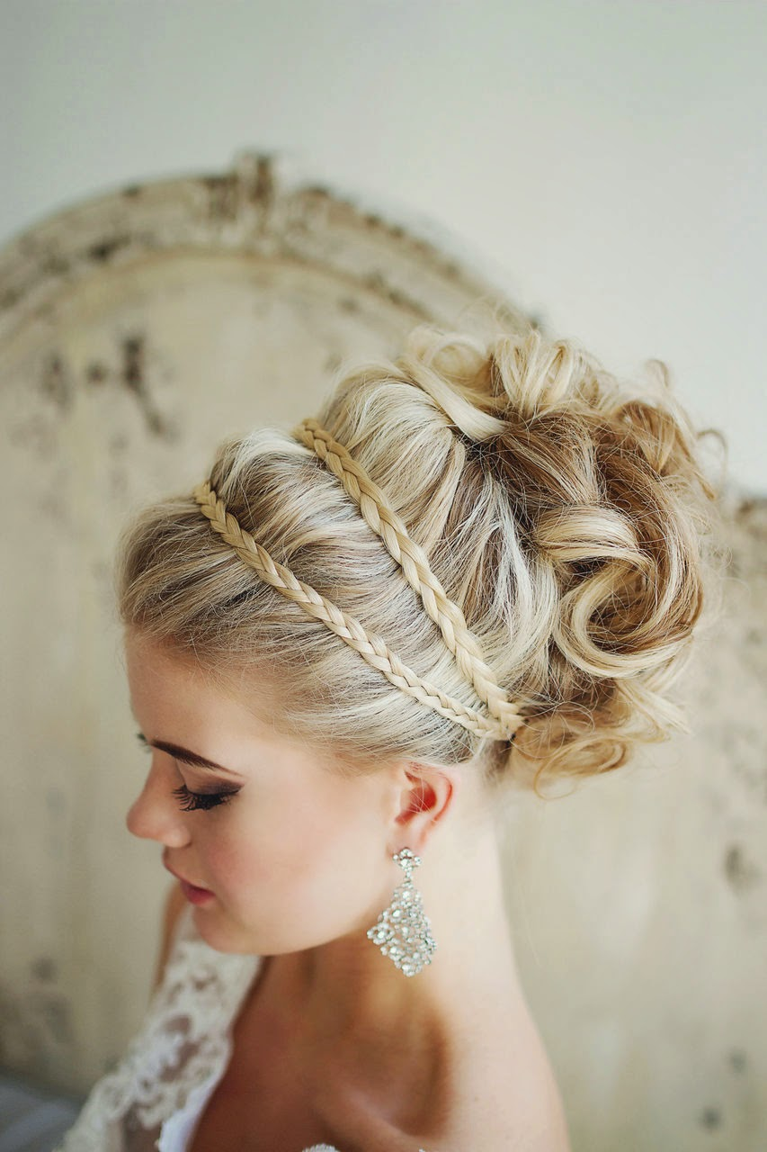 winter wedding up do with braids and sparkly earrings