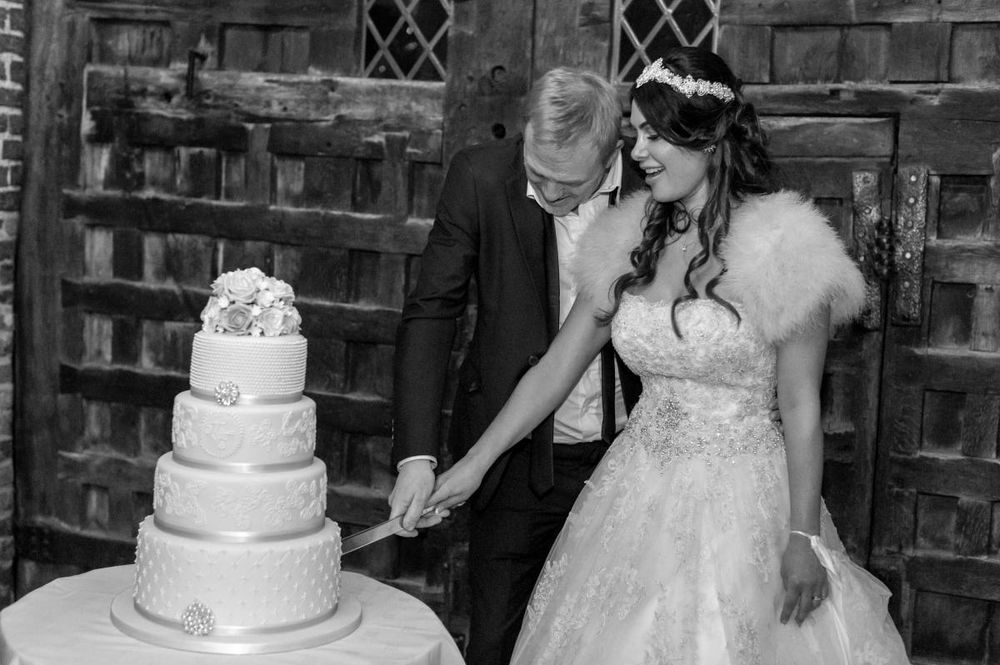 tryfonas wed couple cuts cake black 18
